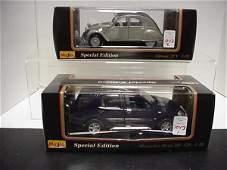 1043: 2 Diecast Metal 1/18 Scale Model Cars: