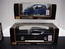 1072: 2 Diecast Metal 1/18 Scale Model Cars: