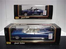 1091: 2 Diecast Metal 1/18 Scale Model Cars: