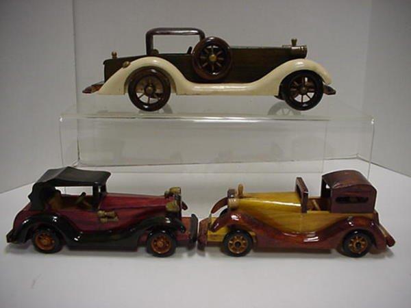 1430: 8 Vintage Wooden Car Replicas.
