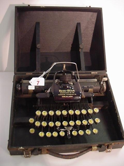 7: REM-BLICK Portable Typewriter with Case: