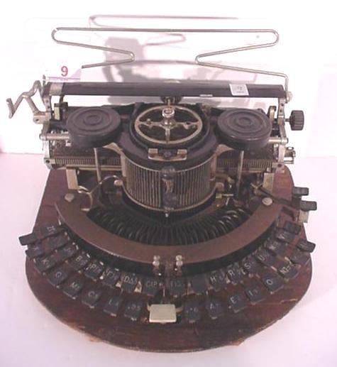 9: HAMMOND Round Portable Typewriter: