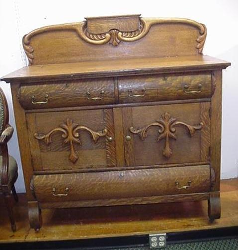 713: Golden Oak Sideboard with Carved Backsplash: