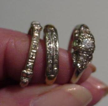 978: 3 Ladies Diamond and Gold Rings: