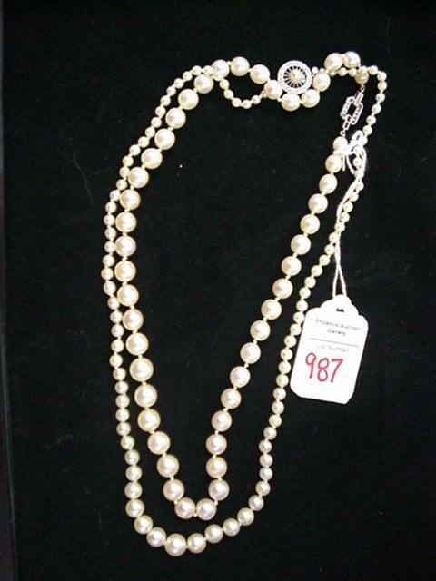 987: 2 Cultured Pearl Necklaces with Diamond Clasps: