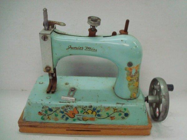 1008: Blue Artcraft JUNIOR MISS Toy Sewing Machine: