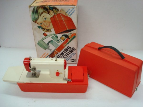 1014: BANDAI Child's Sewing Machine in Case and Box: