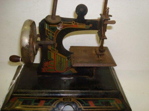 1022: CASIGE Model 116 German Toy Sewing Machine: