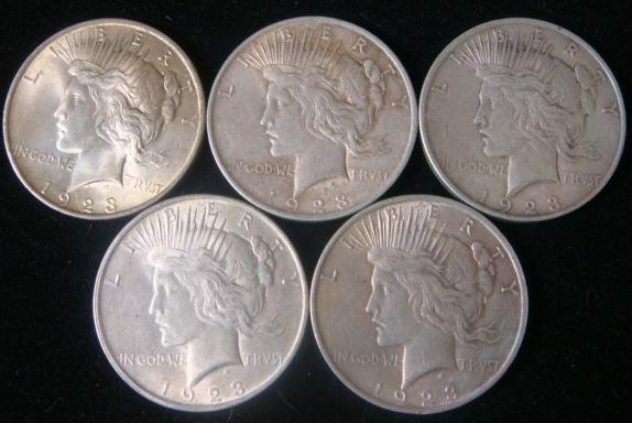 7:  5 1923 PEACE SILVER DOLLARS, AU-50: