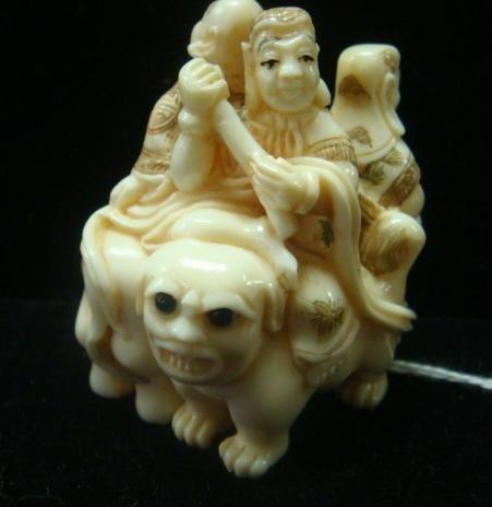 17: Intricately Carved Ivory Netsuke ShiShi, Elephant: