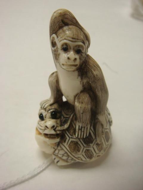 19: Ivory Carved Monkey on Mythical Figure Netsuke: