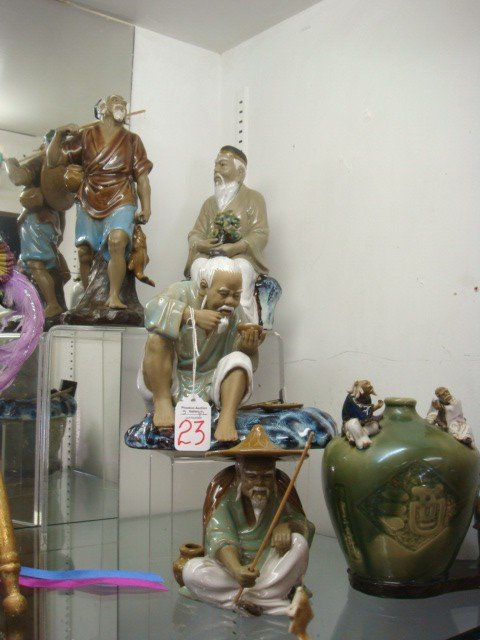 23: Five Handpainted and Glazed Chinese Mud Figurines: