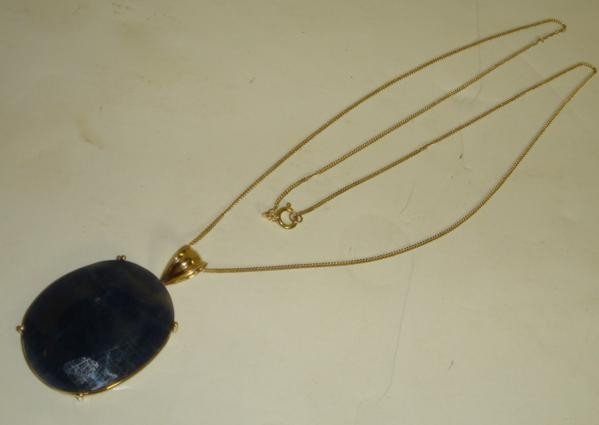 22: 14KT Necklace with 30.8CT Sapphire: