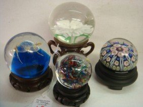 18: Four Paperweights with Wooden Stands: