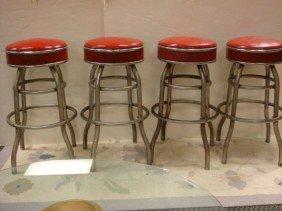 24: Four Vintage Chrome and Plastic Swivel Bar Stools: