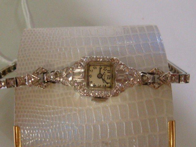 144: Ladies Platinum, 14KT Gold and Diamond Wrist Watch