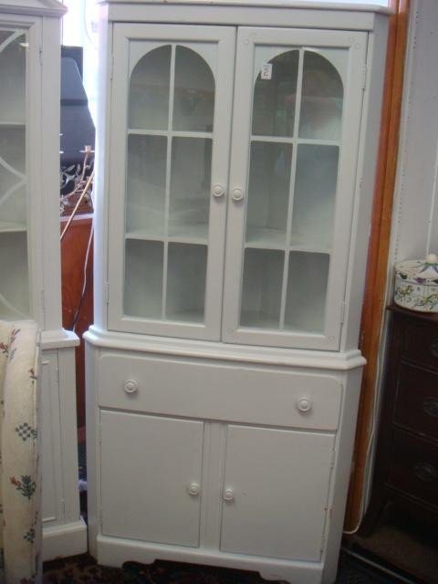 2: White 2 Door Petite Corner Cabinet.