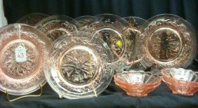 Twelve Pink Glass Plates And Four Bowls: