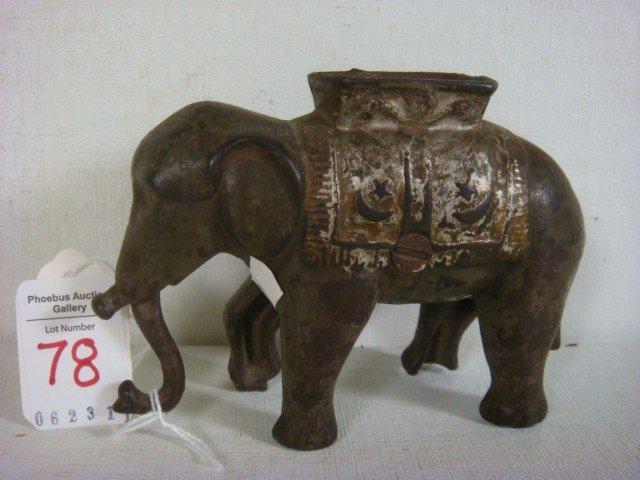 78: Cast Iron Elephant Swinging Trunk Bank: