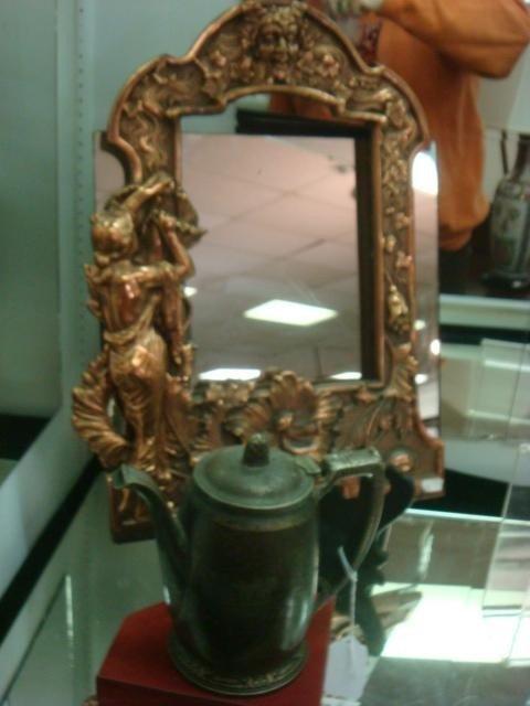 21: Waldorf-Astoria Teapot and Figural Framed Mirror: