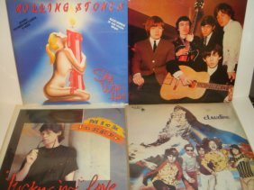 Four ROLLING STO9NES 33 1/3 RPM Records:
