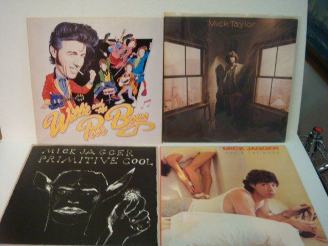 77: Four ROLLING STONES 33 1/3 RPM Records: