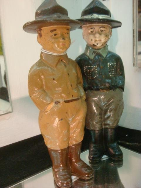 10: Two Cast Iron Boy Scout Still Penny Banks: