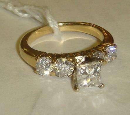 319: Lady's Diamond and Yellow Gold Ring: