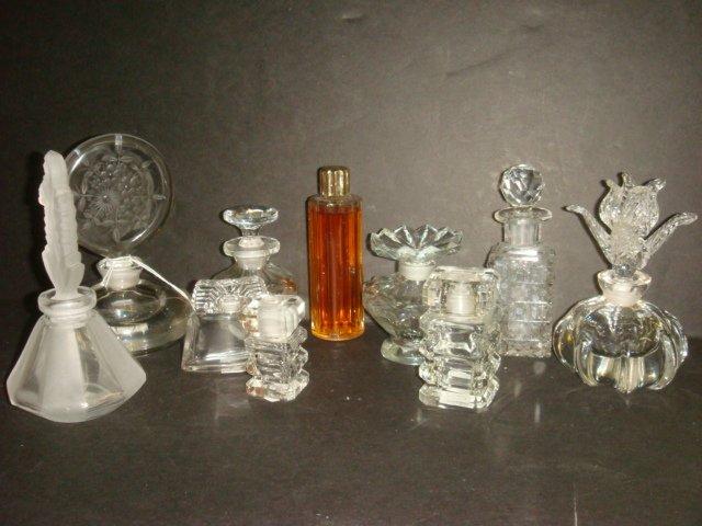 12: Nine Clear Glass Perfume Bottles: