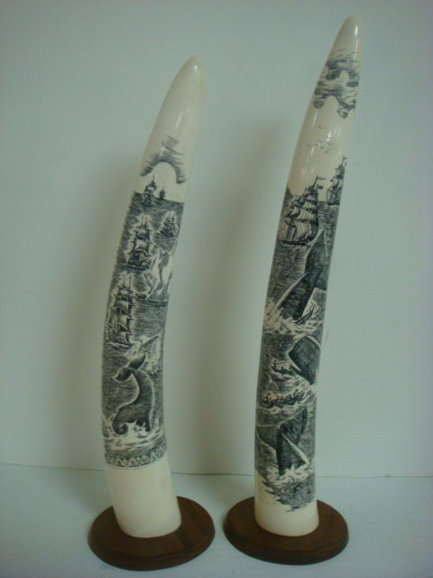Pair of Signed Scrimshaw Decorated Walrus Tusks: