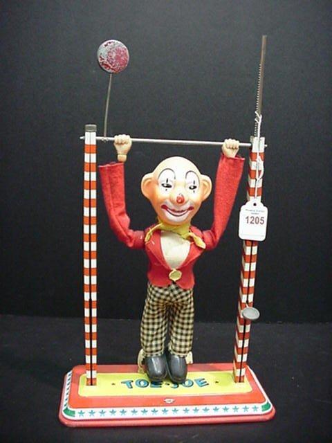 1205: Toe/Joe Tin Litho/Plastic 1950's Clown: