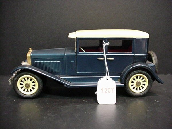 1207: Tin Japanese Model A Ford Friction Toy: