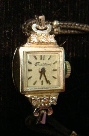 Ladies 14KT Gold and Diamond TRADITION Watch: