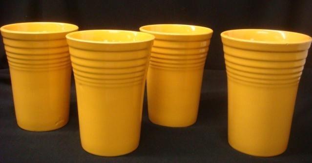 Four Vintage Fiesta Yellow Beakers: