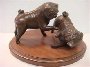 Playful Pugs Figurine on Wooden Base: