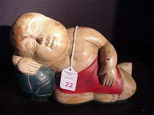 Wooden Reclining Oriental Boy with Tag