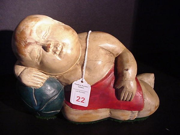 22: Wooden Reclining Oriental Boy with Tag: