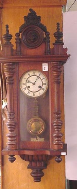 7, German J. Unghaus Walnut Case Wall Clock: Carved Cre
