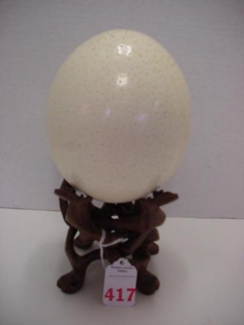 417: Authentic Blown Out Ostrich Egg on Carved Stand: