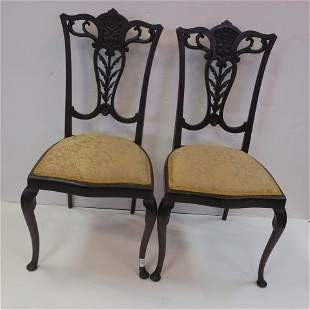 Four Mahogany Side Chairs with Open Carved Backs:
