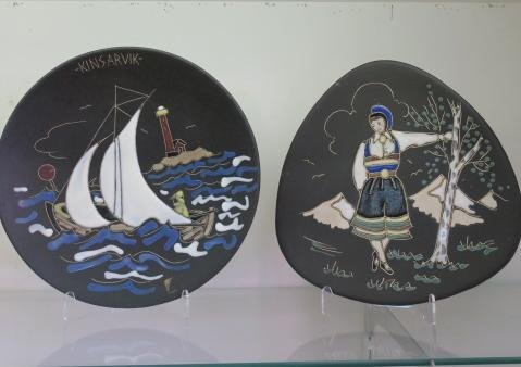 Two Enamel on Matte Black Wall Plaques from Norway: