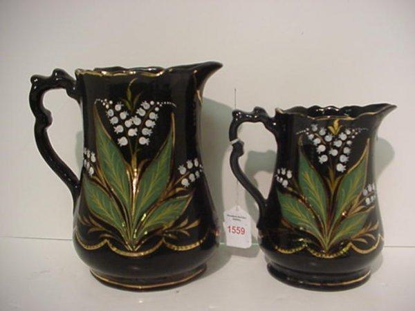 1559: 2 Black Jackfield Ceramic Handpainted Pitchers: