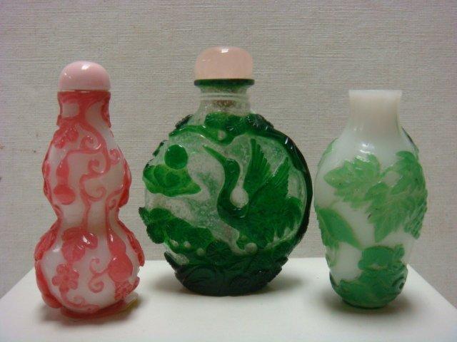 Three Peking Glass Overlay Snuff Bottles: