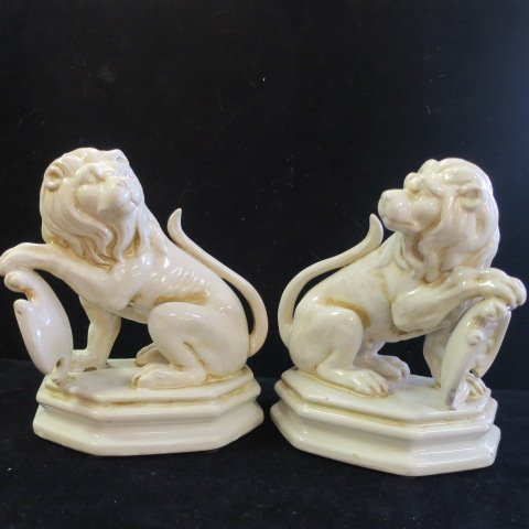 Two Ceramic Seated Lions with Shields: