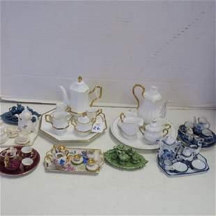 Nine Miniature Doll House Tea Sets: