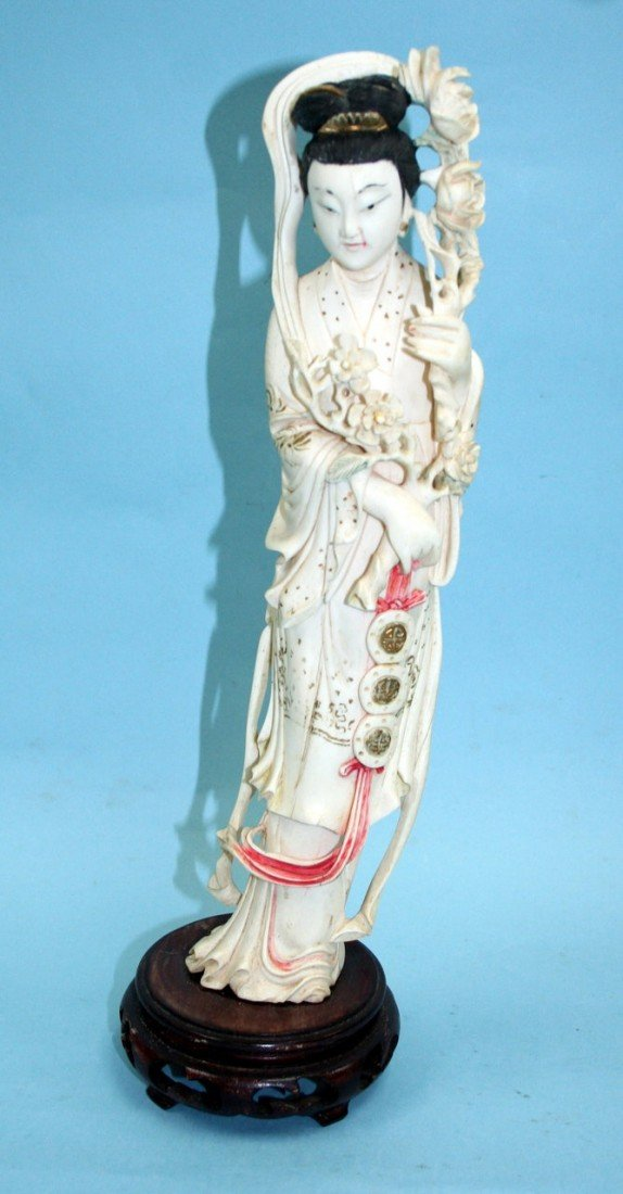111: A well carved Chinese ivory figure of a lady of be