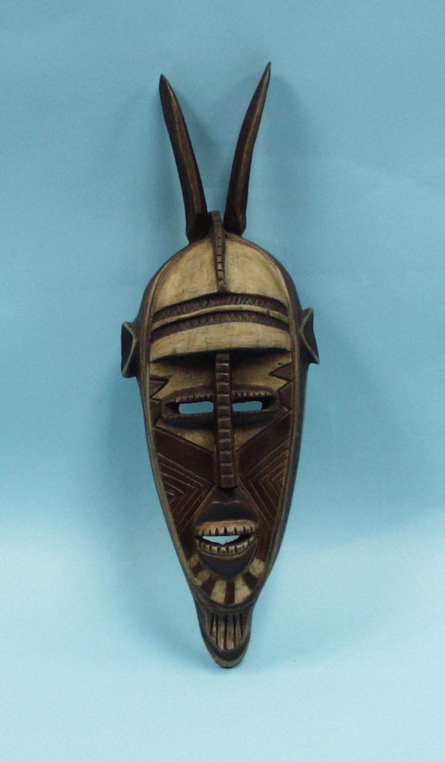 A well carved and hand painted African tribal