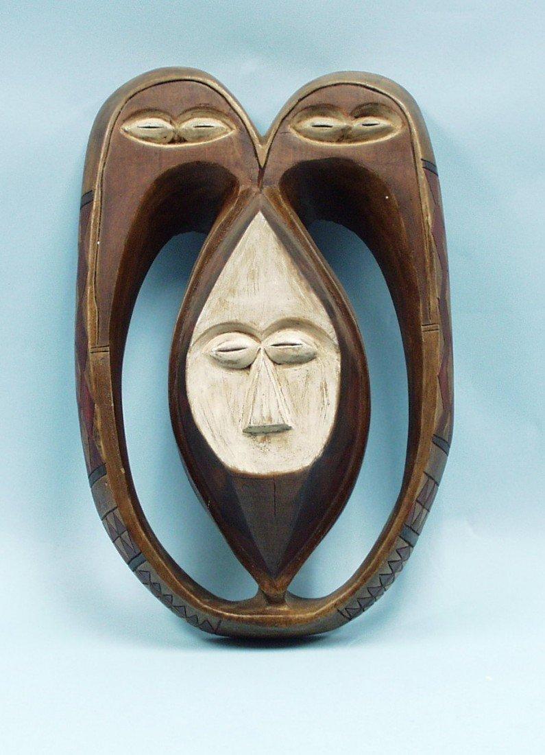 Mask Kwele - An elaborately carved wood Afric