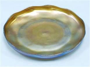 ART NOUVEAU - L.C. Tiffany. A circular iridescent F