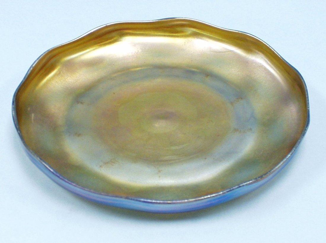 5: ART NOUVEAU - L.C. Tiffany. A  circular iridescent F